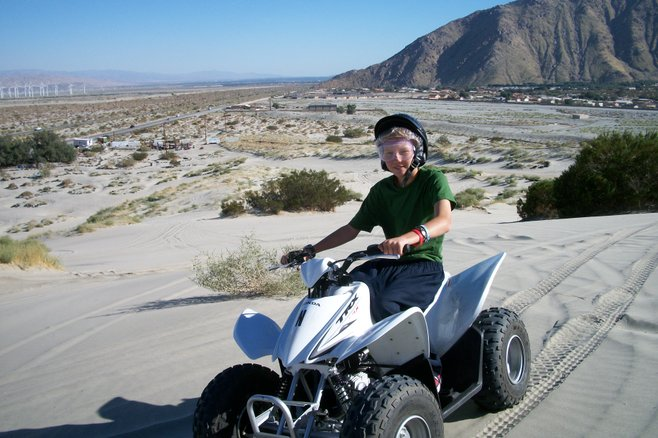 The author's son on a quad