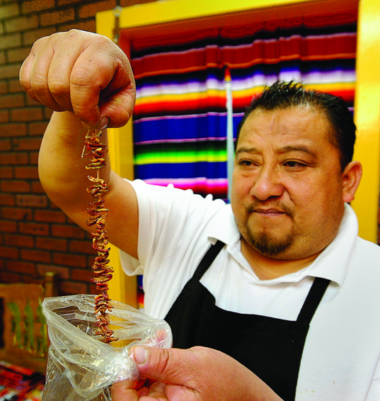 "Co-owner Simon shows off ""gusanos de maguey"" (worms)."