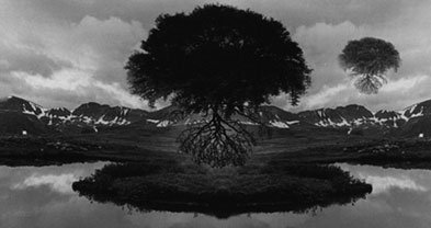 "Untitled, 1969, by Jerry Uelsmann, ""creates a never-before-existent reality that issues more from the unconscious than from waking awareness."""
