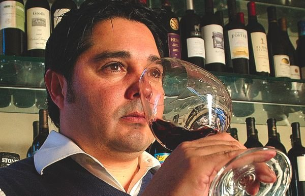 Gilbert, the backbone of the bar, runs it and teaches people about wine.