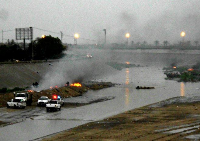 Tijuana police watched as a homeless camp burned.