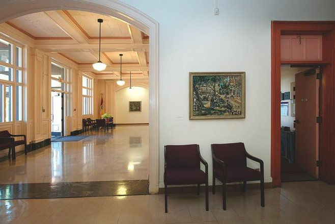 Ivan Messenger's 1934 oil painting Senior Citizens hangs in its new home in the Parks and Recreation offices in Balboa Park.