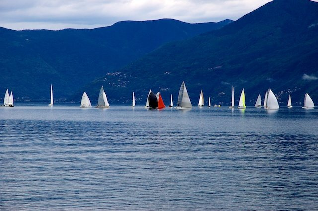 Sailboats on Lago Maggiore, Swiss Alps in the background