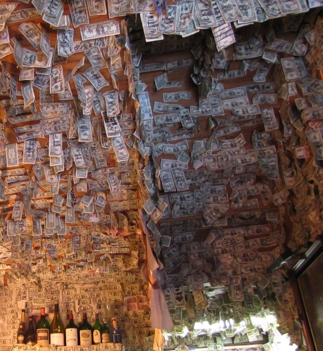 Tasting room ceiling lined with dollar bills