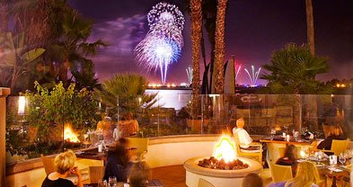 Diners on the terrace at the Mission Bay Hilton's Acqua enjoy a view of SeaWorld's fireworks.