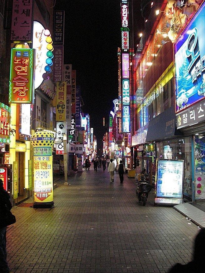 A neon-lit walkway in Busan