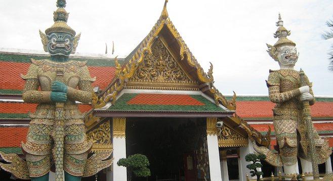 Giants guarding the entrance to Bangkok's Grand Palace
