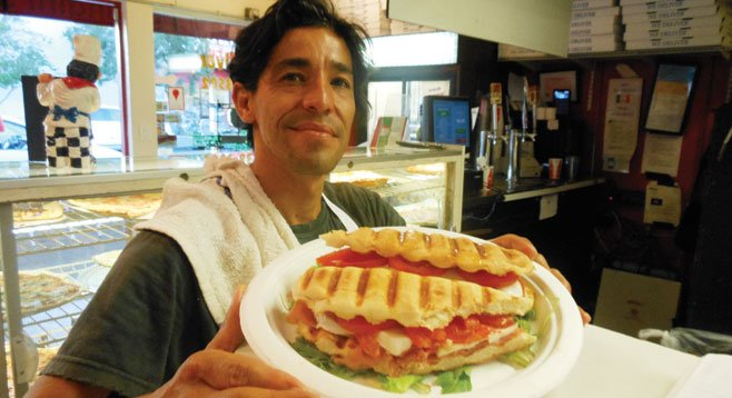 Carlos serves up a Fiorentini panini — prosciutto, mozzarella, tomatoes, and oregano.