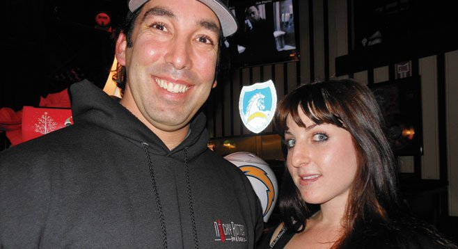 Nicky Rottens owner Nick Tomasello poses with server Jessica.