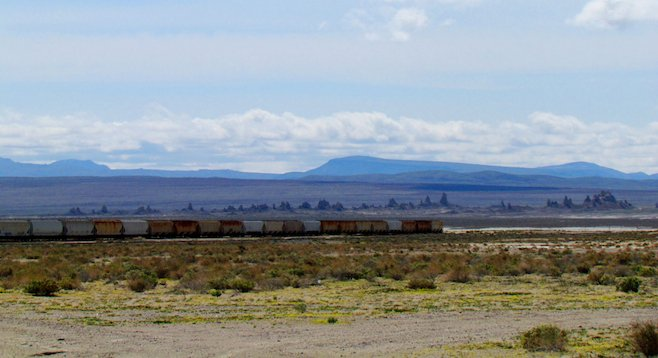 "Abandoned boxcars near the Mojave's ""Cathedral City."""