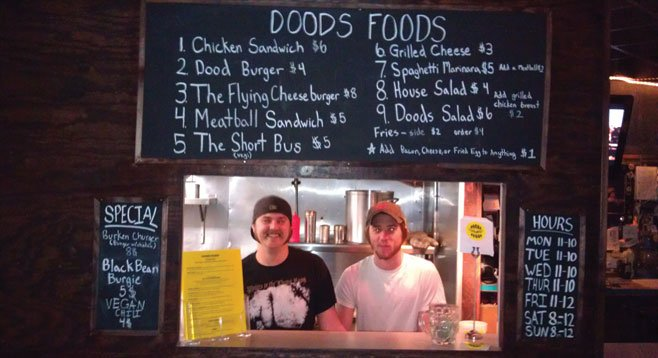 Guerrilla chefs Tommy Pockets and Justin Hulson man the Doods Foods window at Tin Can Ale House.