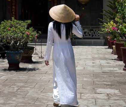Outside a temple in Saigon (Ho Chi Minh City, officially): the classic white ao dai.