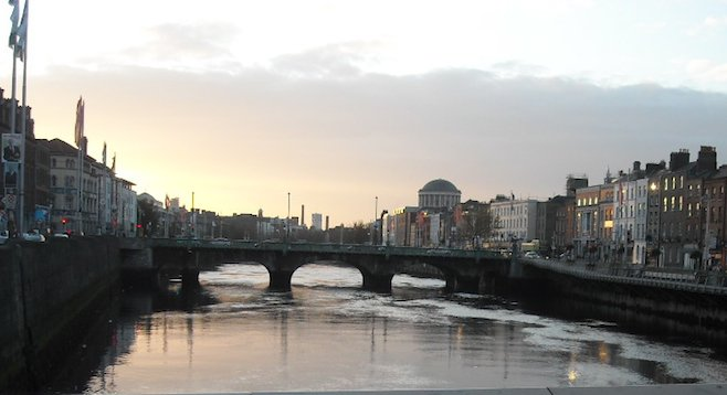 Dublin, bridge over the River Liffey at dusk.