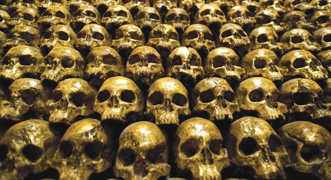 Enjoy a fine bourbon next to a wall of shimmering gold skulls at Noble Experiment.