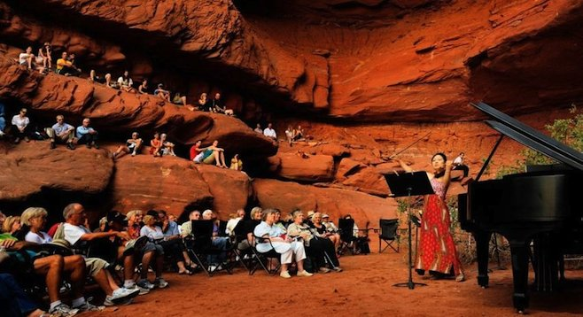 Great acoustics: the festival's Grotto Concerts are held in a natural red stone cave with high, arching ceilings. (photo by Richard Bowditch, reused with permission of moabmusicfest.org)