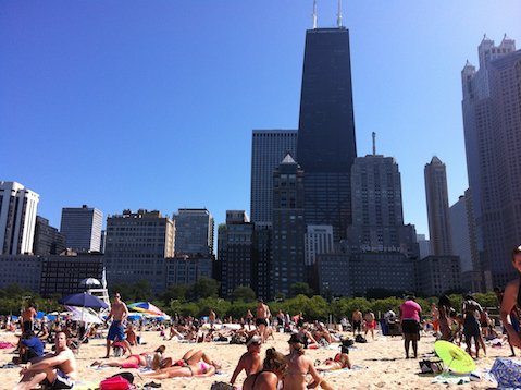 Summer in the city: Chicago's downtown skyline rises up imposingly behind Oak Street beach.