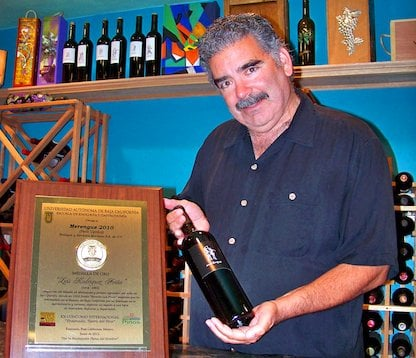 Jay Dworsky with his gold medal plaque for Merengue, a Baja Petit Verdot.