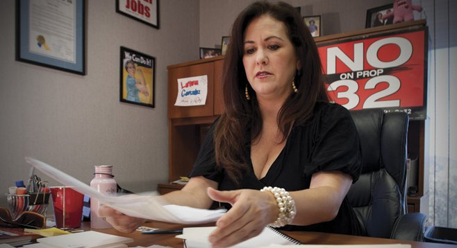 Labor council official Lorena Gonzalez claims Prop 32 would limit unions' political clout while doing little to rein in that of businesses'.