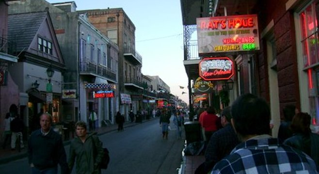 The bars of Bourbon Street aglow at dusk.
