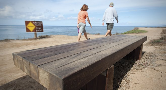 """City officials claim that the tropical ipe wood doesn't require refinishing and sealing.  Jim Grant, who has been restoring decks """"for 20 years,"""" disagrees."""