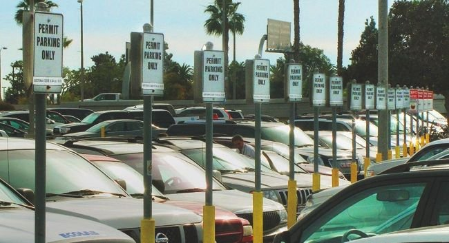 Hundreds of government officials park for free in these spots at the airport. A ban on nonofficial use is not enforced.