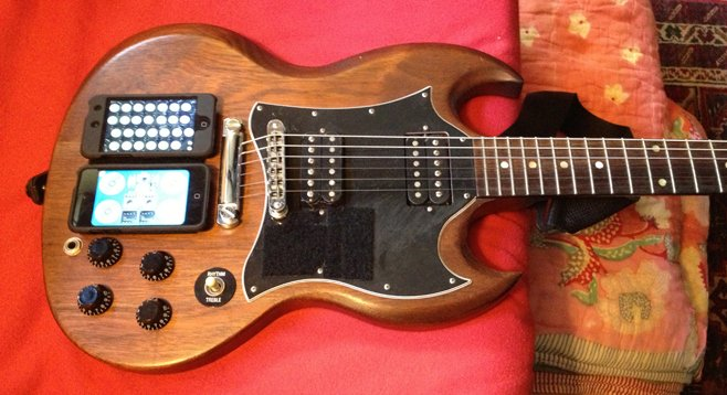 """Radulovich: """"I taped some velcro to my guitar, so now I have an iPhone and iPod mounted on it."""""""