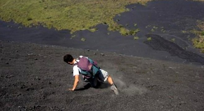 Volcano boarding is a sport all its own –and the board's optional, as this foot-slider on Cerro Negro demonstrates.