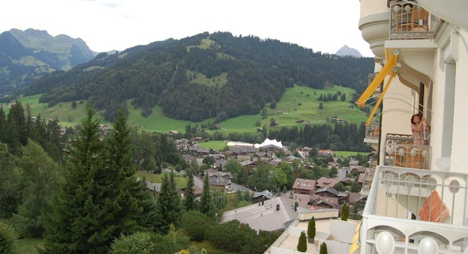 Among Gstaad Palace's amenities are private balcony panoramas of the Swiss Alps.