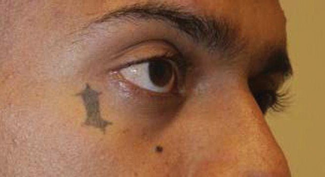 Oceanside gang member Luciano Velasquez's tattoos were used to identify him as the shooter in an attempted triple homicide in Carlsbad.