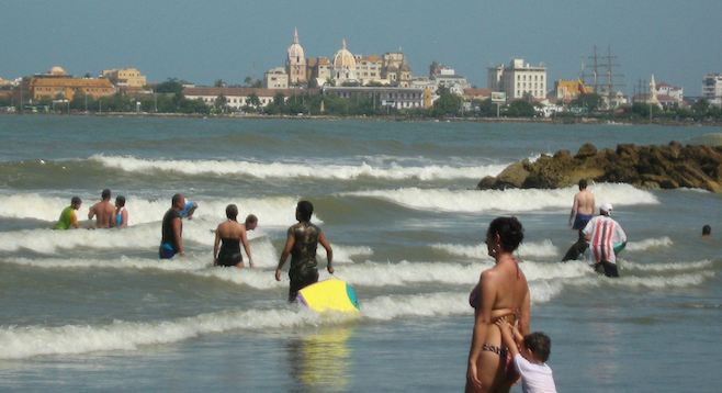 The local beach, with Cartagena's walled Old City across the bay.