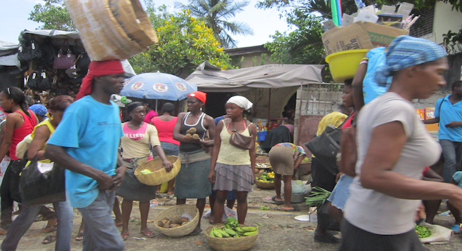Typical street market scene in the Haitian capital.