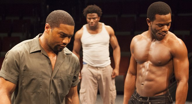 Joshua Elijah Reese as Ogun Henri Size, Okieriete Onaodowan as Oshoosi Size, and Antwayn Hopper as Elegba in The Brothers Size at the Old Globe through February 24.