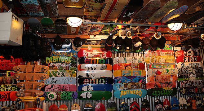 Wall-to-ceiling skateboard decks at Skatelab's museum.