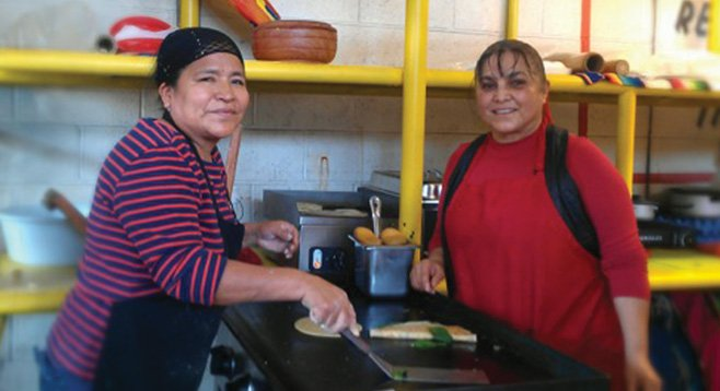 Saida Soto and Mercedes Roman would enjoy not having to haul, set up, and break down their café for every market day.