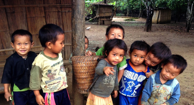 Khmu children in northern Laos, excited to see themselves on camera.