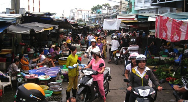 Navigating a crowded Saigon market on a motorbike: not for the faint of heart.