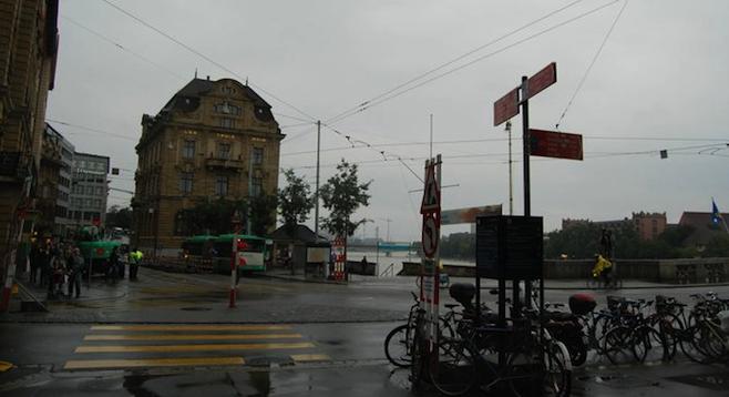 Ubiquitous Swiss trams pass near the five-star Grand Hotel Les Trois Rois.