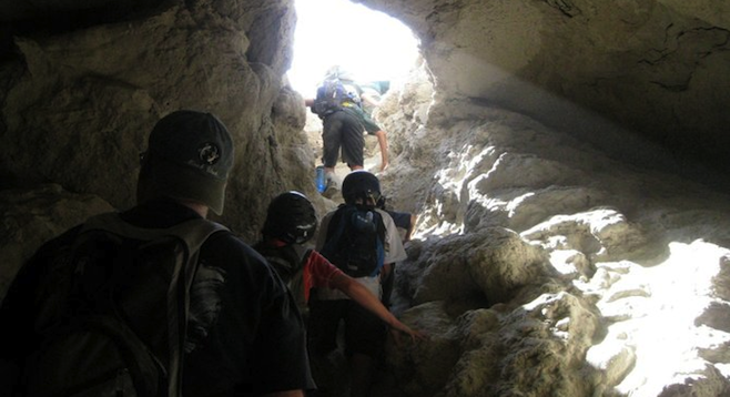 "Climbing out of one of the many ""mud caves"" found in the Anza Borrego Desert. (Photo by Andrew Accardi)"