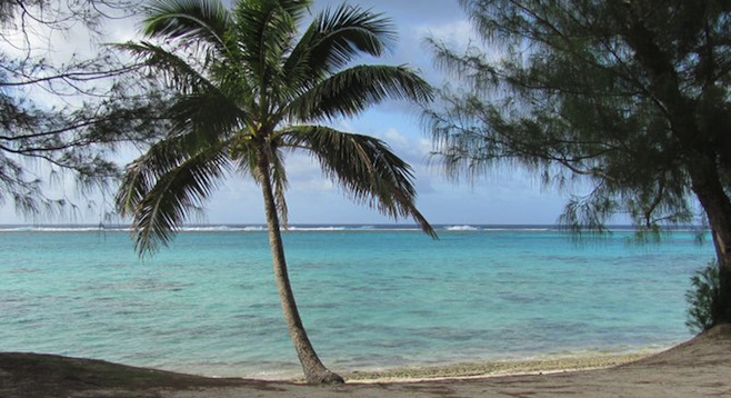 Rarotonga's Raina Beach, reef in the background.