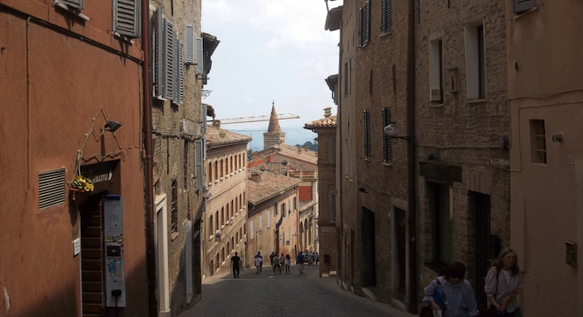 Walking the cobblestone streets in Urbino.