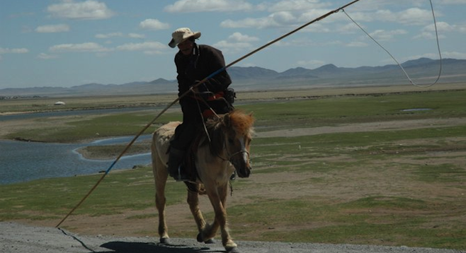 Horseman, Mongolia. Typical sight on the Trans-Mongolian train.