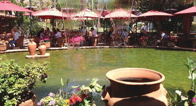 "Our hard-working diva Barbarella likes to unwind with her ""favorite margarita in the world"" near the waterfall at Hacienda de Vega."