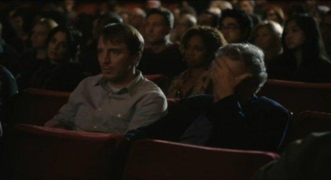Robert De Niro (Robert De Niro) and another actor (not Robert De Niro) attend a Robert De Niro movie marathon in this commercial for Santander Bank starring Robert De Niro.