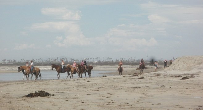 Equestrians on the beach at Border Field State Park, 1.5 miles north of the border by the Tijuana River mouth.
