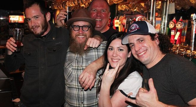 Scot and Karen Blair (front and center) with Monkey Paw brewers Cosimo Sorrentino (right), Chris West and Nickel Beer Co./O'Brien's Pub owner Tom Nickel (center back).
