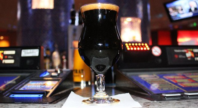 Iron Fist Velvet Glove imperial stout served among computer poker consoles at Corked in Harrah's Resort Southern California.