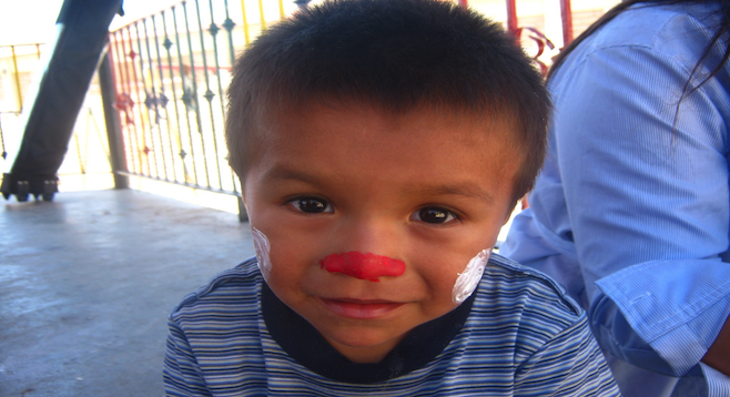 Face painting time at Tijuana's Casa Hogar El Faro orphanage.