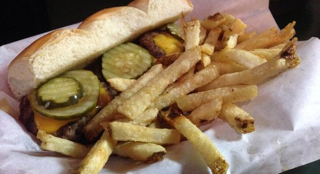 Everybody gets a pickle. Sliders. Lefty's Chicago Pizzeria.