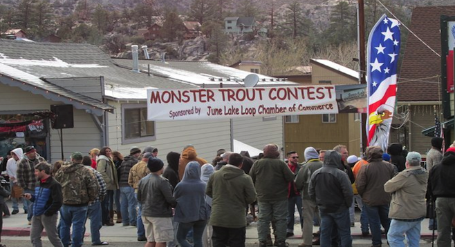 A crowd gathers in June Lake to see the largest trout in the annual Monster Trout Contest.