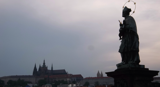 Looking out from Prague's 14th-century Charles Bridge to the hilltop castle.